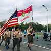 Scouts from Billerica Troop 11 presented the colors before the road race. Bruce the Turtle (Ava Gottman-Hanrahan) helped Sydney Petcher of Billerica warm up before the Dewey Dash. Photo by Mary Leach