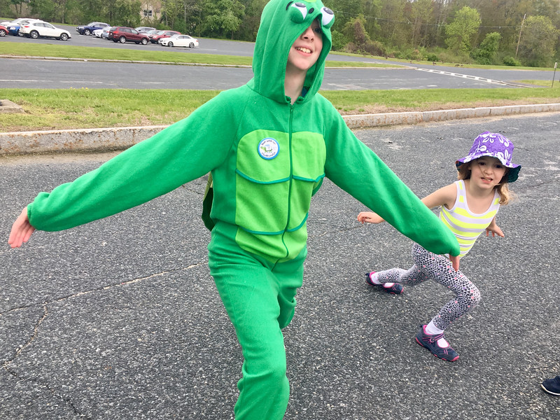 Bruce the Turtle (Ava Gottman-Hanrahan) helped Sydney Petcher of Billerica warm up before the Dewey Dash. Photo by Mary Leach