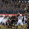 Photo courtesy of DON TOOTHAKER/toothakerphoto.com While Navy and Army audience members look on in uniform, Cadets running back Raymond Maples picks up yardage on Saturday in Philadelphia during the Army v. Navy football game held at Lincoln Financial Field.  Army fell for the 11th straight year to Navy, 17-13.
