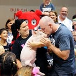 Principal kisses pig!!! Tony Duffy of Mt Tabor kissed a pig at the fall festival!!! <br /> <br /> Photographer's Name: angela snelling<br /> Photographer's City and State: jeff, IN