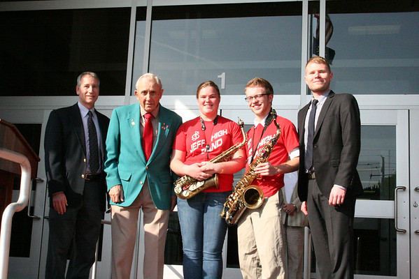 The Jeff High Band presented John Woehrle with a  plaque thanking him for his contribution to the band program. Pictured are Ken Smith, Band Booster President; Mackenzie Miller and TJ Puckett, band members; Scott Cooksey, Director of Bands; and John Woehrle.<br /> <br /> Photographer's Name: Becky Herald<br /> Photographer's City and State: Jeffersonville, IN