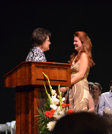 Rae Lynn Carter, at right, accepting the Helen Reschar Memorial Scholarship from Nancy Dodds representing the Delta Phi Chapter of the Sigma Phi Gamma International Sorority at the Jeffersonville High School Honors Night.<br /> <br /> Photographer's Name: Charles Smith<br /> Photographer's City and State: Jeffersonville, IN