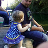 Dave Nelson Jr sittin on the dock with daughter, Rylan, 1 year old<br /> <br /> Photographer's Name: Maggie  Nelson<br /> Photographer's City and State: kokomo, IN