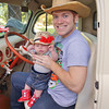 Jeff and 2 month old Evelyn Noren pose in a 30's era Ford F1 they awarded the plaque they sponsored for the Bill Murphy Memorial Car Show on August 11th.<br /> <br /> Photographer's Name: Mollee Noren<br /> Photographer's City and State: Kokomo, IN