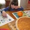 While waiting for the family Christmas party to begin, Sophia Hite decorated an orange with cloves. <br /> <br /> Photographer's Name: Roberta Hite<br /> Photographer's City and State: Kokomo, IN