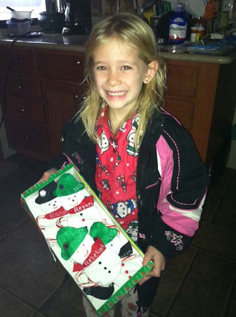 Regan McGuire shows off Christmas decorations she made with her Grandmother Belva.<br /> <br /> Submitted by Belva Likens.