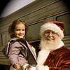 This photo, taken at the Polar Bear Express train ride at Indiana Transportation Museum, is the first Santa Claus with which Claire Rush, 4, has had her picture taken with willingly since she was a baby.<br /> <br /> Submitted by Danielle Rush.