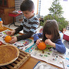 While waiting for the family Christmas party to begin, Jack Hite and his sister Sophia decorated oranges with cloves. <br /> <br /> Photographer's Name: Roberta Hite<br /> Photographer's City and State: Kokomo, IN