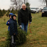 Grant Walker (back, in blue) and Jack Hite (front) help Grandpa Larry Hite carry a Christmas tree to the truck.<br /> <br /> Submitted by Roberta Hite.