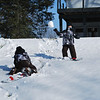 Nolan look out!!!!  A snow boulder is coming your way!!!  Nolan Kesser dodges a giant snowball thrown by Justin Hurlock!<br /> <br /> Photographer's Name: cindy gross<br /> Photographer's City and State: Kokomo, IN