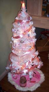 Jane Miller, a 26-year breast cancer survivor, decided to decorate a tree in honor of all breast cancer patients and survivors, including her sister, a 12-year survivor, and a good friend who was diagnosed with fast-growing breast cancer and is going through the rigors of chemotherapy.<br /> <br /> Submitted by Jane Mitchell.