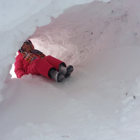 Aayla Wise going down her snow slide inside her snow fort<br /> <br /> Photographer's Name: Heather Reed<br /> Photographer's City and State: Kokomo, IN