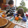 While waiting for the family Christmas party to begin, Jack Hite and his sister Sophia decorate oranges with cloves.<br /> <br /> Submitted by Roberta Hite.
