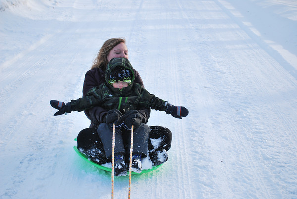 Making the best of this crazy winter...Maranda Douglas and Hunter West being pulled by Chad McGuire on a 4 wheeler.<br /> <br /> Photographer's Name: Nell Douglas<br /> Photographer's City and State: Kokomo, IN