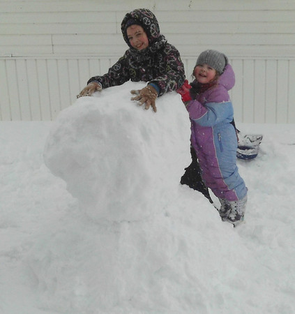 Devin & Riley building snowman<br /> <br /> Photographer's Name: Beth Forker<br /> Photographer's City and State: Kokomo, IN