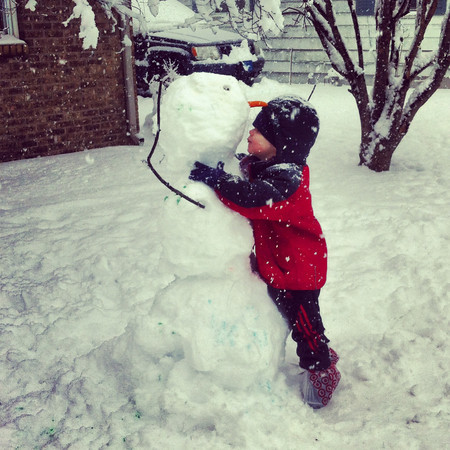Carter Petrey giving his snowman a goodbye kiss<br /> <br /> Photographer's Name: Amy Petrey<br /> Photographer's City and State: Kokomo, IN