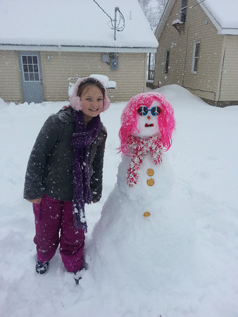 Destiny Bratcher made a snow friend named Jeanette during the snow storm<br /> <br /> Photographer's Name: cathy bratcher<br /> Photographer's City and State: kokomo, IN