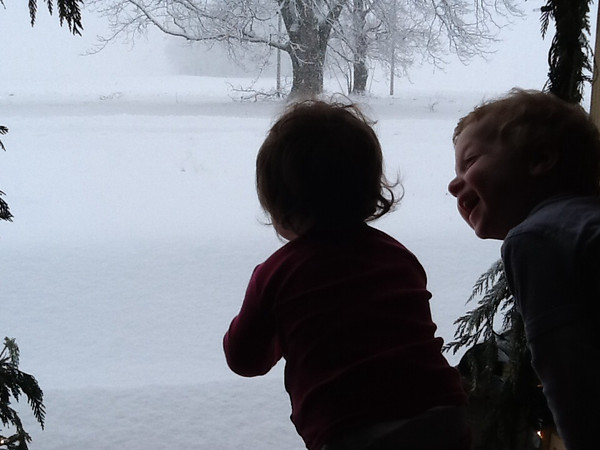 Big brother is excited for his sister to see the snow!<br /> <br /> Photographer's Name: Megan Merrell<br /> Photographer's City and State: Kokomo, IN