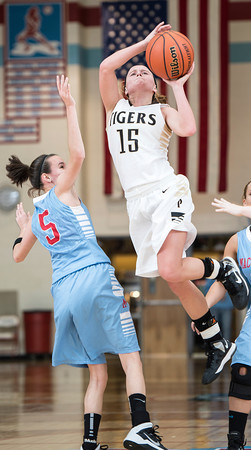 Peru Lady Tiger's Josie Murphy drives the lane for two<br /> <br /> Photographer's Name: Keith Dinn<br /> Photographer's City and State: Bunker Hill, IN