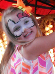 Ava Flanigan, 4, rides the carousel at the Howard County 4-H Fair last week. Photo submitted by Malary Flanigan