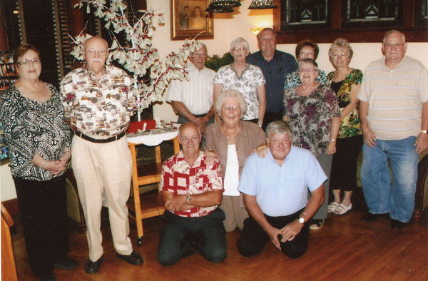 """Young America Class of 1962, 50th Class Reunion met in Sept. with  dinner, to reminisce and honor there principal, Mr. Hendrix. They presented him with a money tree to say """"thank you"""" and to tell him how much he meant to them. Attending are (left to right) Mr and Mrs. Robert Hendrix, (kneeling) Tom Robertson, Don Nelson and Karen Buettner Pencek, (standing) Edie Manning, Patty Krise Trurin, Bill Johnson, Ruthie Smith Duvall, Linda Prather Nelson, Pam Shawver Wilson and Howard Turnpaugh. Unable to attend was Joe Williams.<br /> Submitted by: Karen Pencek"""