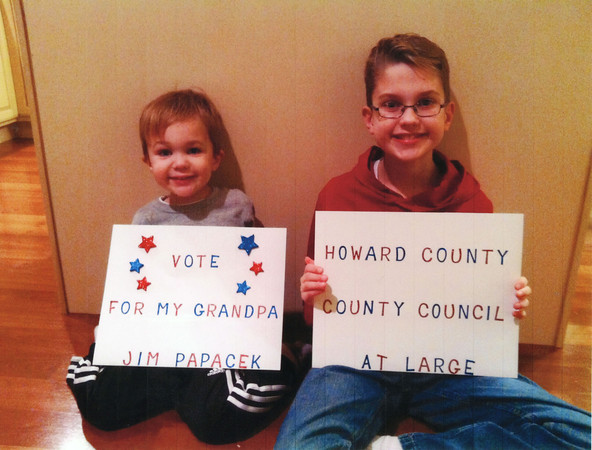 Derek, left, and Dean Rhoda hold campaign signs for their grandpa, Jim Papacek.<br /> Submitted by Jim Papacek