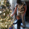 Gavin Haynes, 2, helps decorate the Christmas tree with his grandma Thanksgiving weekend.<br /> <br /> Submitted by Cathy Bratcher.