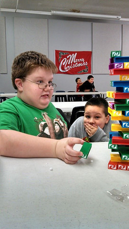 Sam Evans, left, and Nathan Rush participate in an intense game of Uno Stacko during a meeting of Cub Scout Pack 3520, Greentown<br /> <br /> Photographer's Name: Danielle Rush<br /> Photographer's City and State: Greentown, IN