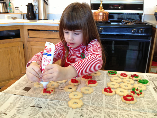 Sophia Hite concentrated while decorating cookies at Grandma and Grandpa Hite's home.<br /> <br /> Photographer's Name: Roberta Hite<br /> Photographer's City and State: Kokomo, IN