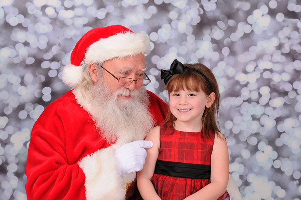 "She is thinking, ""I got this!"" First time seeing Santa this year.<br /> <br /> Photographer's Name:  <br /> Photographers City and Country: ,"