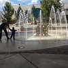 Tim Smith helps 2-year-old son Emery Smith see (and touch) the new fountain at city hall. Photo submitted by Whitney Smith
