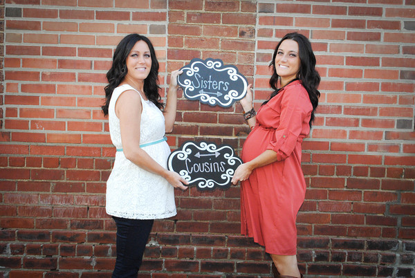Sisters....Kristen Beauchamp & Kayla Winger sharing a special moment taking maternity pictures downtown Kokomo.<br /> <br /> Photographer's Name: Rhonda Blinn<br /> Photographer's City and State: Galveston, IN