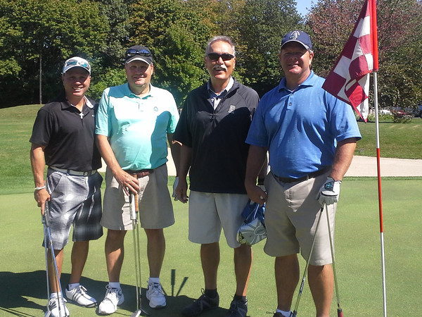 Mike Roth, Frank Caldwell, Dave Winteregg, Dave Mann at the golf outing Sept. 23 to benefit Tomorrow's Hope.