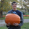 gabriel putman with his pumpkin he picked out to carve<br /> <br /> Photographer's Name: darla kelley<br /> Photographer's City and State: kokomo, IN