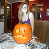 victoria putman with her mustache pumpkin she carved<br /> <br /> Photographer's Name: darla kelley<br /> Photographer's City and State: kokomo, IN