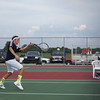 Austin Dukes, No. 2 Doubles for Western High School Tennis Team, returns a shot during their match against Northwestern.<br /> <br /> Photographer's Name: Scott Quinn<br /> Photographer's City and State: Russiaville, IN