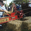 Don baling straw, with a 1/3 scale model Case baler<br /> <br /> Photographer's Name: Don  Croddy<br /> Photographer's City and State: Kokomo, IN