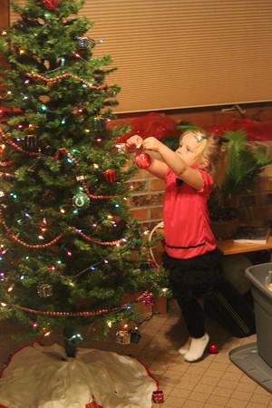 Journie Hale reaches to put an ornament on Papaw & Nana Cassis's Christmas Tree.<br /> <br /> Photographer's Name: Jane Cassis<br /> Photographer's City and State: Kokomo, IN