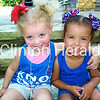Jharia Knox and Jenna Dunlap relax on the steps at The Knox Family Reunion at Eagle Point Park<br /> <br /> Photographer's Name: Mindy Dunlap<br /> Photographer's City and State: Clinton, IA