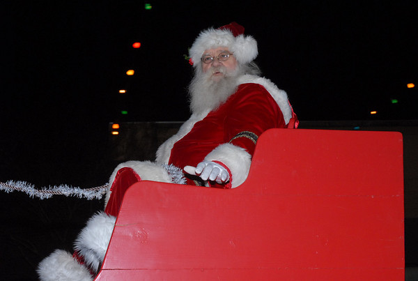 St. Nick waves from a sleigh atop a truck at the end of the Moultrie Christmas Parade Thursday, Dec. 12, 2013, in downtown Moultrie.<br /> <br /> Photographer's Name: Kevin Hall<br /> Photographer's City and State: Moultrie, GA