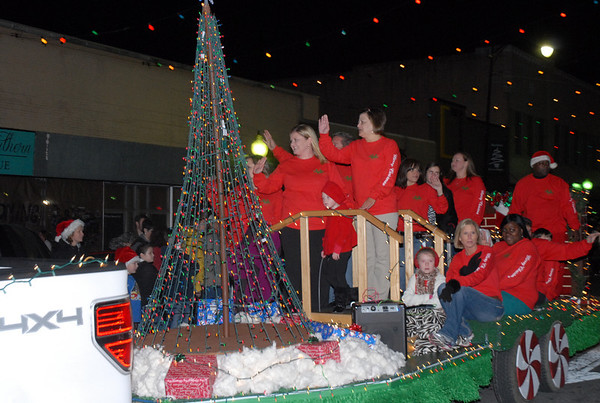 UniHealth Magnolia Manor South presented a choir on its float in the Christmas Parade Thursday, Dec. 12, 2013.<br /> <br /> Photographer's Name: Kevin Hall<br /> Photographer's City and State: Moultrie, GA