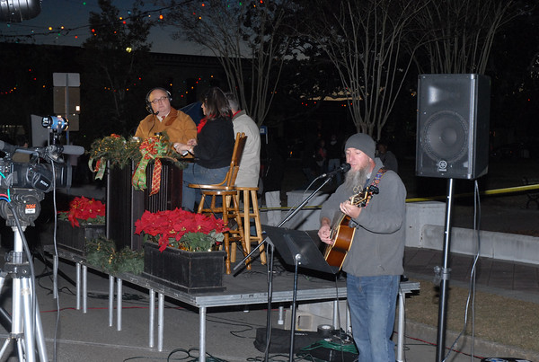 Daniel Parrish sings a Christmas song before the start of Moultrie's Christmas parade on the Courthouse Square Thursday, Dec. 12, 2013.  Photographer's Name: Kevin Hall Photographer's City and State: Moultrie, GA