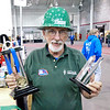 Dan Newby, Lead Mentor for the local FIRST Robotics Team, 447, shows off trophies that the team won earlier this year in Cincinnati.  Dan won the Woody Flowers Award for his dedication to the team and FIRST Robotics at the competition held in Terre Haute April 5th.  The team will next compete in St. Louis at the Championship held April 24 to 27.  Photo by U.S. Mass Communications Specialist Seaman Phillip Stuart.<br /> <br /> Photographer's Name: Mary Stuart<br /> Photographer's City and State: Anderson, IN