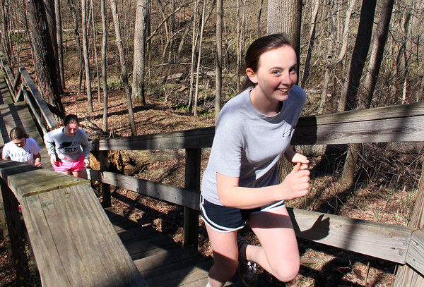 It was a beautiful day for jogging at Mounds Park, as these gals were 'testing' the boardwalk steps.<br /> <br /> Photographer's Name: Jerry Byard<br /> Photographer's City and State: Anderson, Ind.