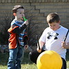 Mason Mnderman and Dylan McDaniel take advantage of the warm weather to practice their musical talents.<br /> <br /> Photographer's Name: Brian Fox<br /> Photographer's City and State: Anderson, Ind.