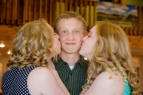 My son Dawson get kisses from sisters Cassandra and Briana.<br /> <br /> Photographer's Name: Terry Lynn Ayers<br /> Photographer's City and State: Anderson, Ind.