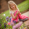 My granddaughter Kambria Fox playing with spring flowers.<br /> <br /> Photographer's Name: Terry Lynn  Ayers<br /> Photographer's City and State: Anderson, Ind.