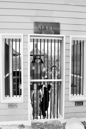 Daughter and grandchildren in fake jail in Carmel park.<br /> <br /> Photographer's Name: Rebecca Reding<br /> Photographer's City and State: Anderson, Ind.