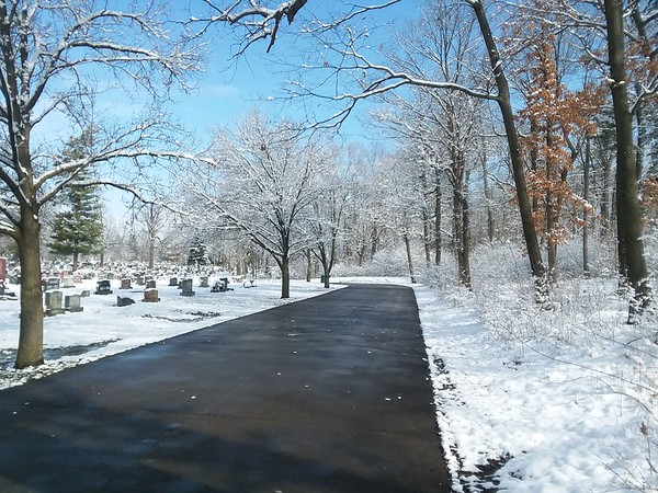 Maplewood Cemetery roadway showing signs that winter does not want to go away just yet.<br /> <br /> Photographer's Name: Pete Dodd<br /> Photographer's City and State: Anderson, Ind.