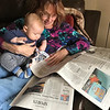 Great Grandma Teena reading The Herald Bulletin with Easton Cash Reed<br /> <br /> Photographer's Name: Chrislyn Reed<br /> Photographer's City and State: Anderson, Ind.